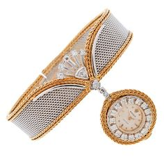 ROLEX 1960's  Ladies Bracelet Watch sold by 'Serpico y Laino'  This is an unbelievable example of a highly stylized and unique vintage Rolex Timepiece. Crafted entirely of 18 karat Gold, the bracelet is a fine White Gold mesh with an intricately braided border of Yellow Gold. Suspended from the bracelet is a manual wind pendant Rolex watch, framed in Diamonds. A burst of Diamonds crowns the top. This piece was meant for a lady with a small wrist, as it measures just 6 inches in overall…