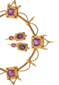 GOLD, AMETHYST AND SEED PEARL DEMI-PARURE, CIRCA 1870 Comprising: necklace and pair of earrings, each composed of plaques set with oval or circular-cut amethysts and seed pearls, the necklace connected by fancy curb chain linking, suspending swags and pipkin drops, length approximately 420mm, earrings with post fittings.