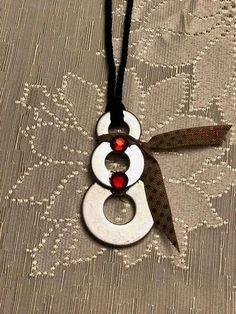$25.30 · Snowman Christmas neckllace this cute little snowman made with washers red gems and fabric scarf, necklace made with black cording with lobster claw closure. Great for Christmas and would make a great gift #diychristmasdecor