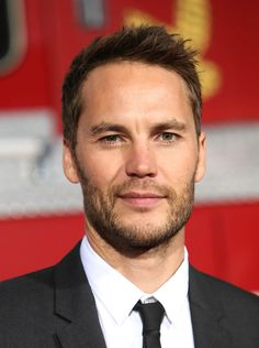Taylor Kitsch can't throw a football for sh-t while playing for charity on Ellen