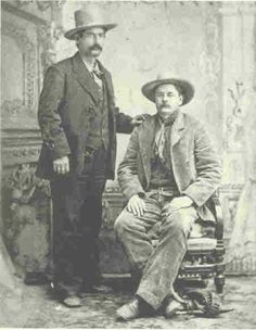 Bob Olinger and Tony Neis  This photo was taken in Santa Fe, New Mexico on March 1, 1881, eight weeks before Olinger was shot and killed by Billy the Kid at Lincoln. Both Neis and Olinger composed part of the group that escorted Billy the Kid to La Mesilla to stand trial.