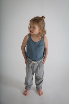 NEW Summer Tanktop & Summer Pleated Pant. This summer we've chosen for a nonchalance fit: clean, elegant en relaxed. For oversized T-dresses, pleated pants, gilets and shortleg salopettes. #summertanktop #pleatedpant #gilet #summerkids #graylabel