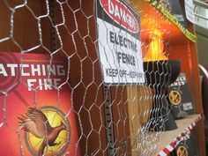 Very cool classroom or library display for The Hunger Games trilogy. {District 12 fence using chicken wire} img_1207.jpg (1600×1200)