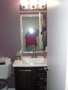 This shot of the vanity is a little better. Oh yeah, changed the light, but need to have the electrician come back to have the light facing down...duh, men can be a trip.