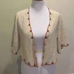 Anthropologie Knitted & Knotted shrug/wrap Beautiful cream knitted wrap/cardigan with embroidered floral pattern adorning the edges. Never worn. No trades. No modeling. Anthropologie Sweaters Shrugs & Ponchos