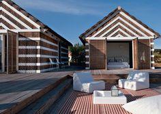 Timber & straw cabanas in Lisbon, Portugal by architects João and Pedro Ferreira de Almeida Pinto
