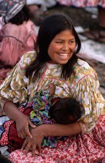 Beautiful patite girl breastfeeding