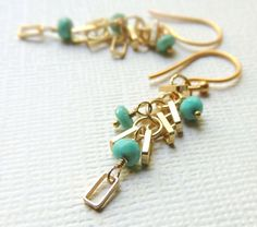 matte gold geometric earrings with sleeping beauty turquoise by flow designs
