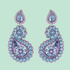 "Chopard - collection ""Red Carpet"" - clips d'oreilles en or blanc, diamants, saphir bleus, rose et violet, de topaes et d'améthystes."