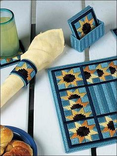 Plastic Canvas - Bring some sunflowers into your home with this 4 piece set that includes napkin holder, napkin ring, coaster and place mat. All are stitched on plastic canvas with worsted weight yarn. Plastic Canvas Coasters, Plastic Canvas Stitches, Plastic Canvas Tissue Boxes, Plastic Canvas Crafts, Plastic Canvas Patterns, Mochila Crochet, Crochet Bag Tutorials, Needlepoint Patterns, Double Crochet