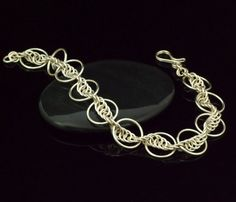 This listing is for all the materials you need to make this Complicated Single Spiral Bracelet! I have included my expertly made jump rings in