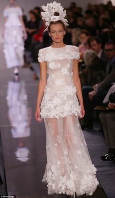The original dress walked down the Chanel Haute Couture spring 2009 runway, with the the m...