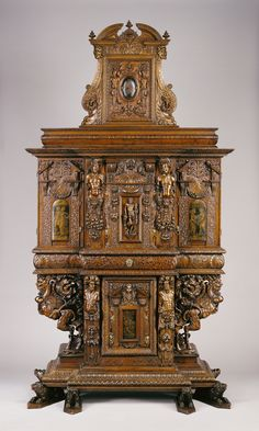 Cabinet.  Artist/Maker(s): Unknown.  Culture: French.  Place(s): Burgundy, France (Place created).  Date: 1580; minor additions in late 1850s.  Medium: Walnut, oak, paint, and iron; linen-and-silk lining.