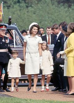 Jackie Kennedy, and her children, Caroline and John Jr. in England, 1965.