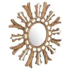 "Wall mirror with openwork wood frame.  Product: MirrorConstruction Material: Wood and mirrored glassColor: GoldDimensions: 21.5"" Diameter"