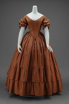 Dinner dress, silk faille embroidered with silk, lined with glazed cotton with sleeves lined with cotton gauze and stiffened with whalebone, c. 1840, American.