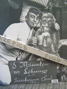 Close up of a corner of a photo. A German soldier posing with a cardboard monkey. I don't like the ruler running across the page, but I really like the monkey.