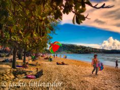 Beach people vendors sun impression Patong Phuket Thailand