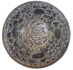 Image from http://www.sawankhalok.com/files/nanyang_fishplate.jpg.