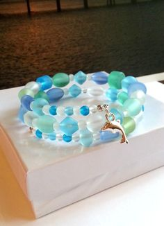 Seaglass beads memory wire bracelet, ladies handmade beach jewelry, glass dolphin charm bracelet