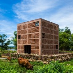 Tropical Space uses perforated brickwork to build riverside pottery studio in Vietnam