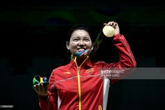 Gold medal winner China's Zhang Mengxue celebrates on the podium during the medal ceremony for the women's 10m air pistol shooting event at the Rio 2016 Olympic Games at the Olympic Shooting Centre in Rio de Janeiro on August 7, 2016. / AFP / PHILIPPE
