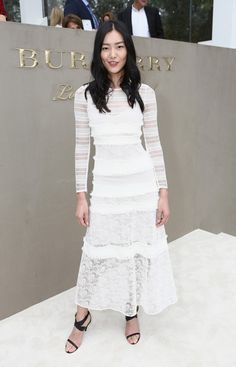 Liu Wen wears a white lace tiered Burberry Prorsum midi dress with strappy sandals