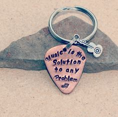 Music is the solution Copper Guitar Pick Keychain with Guitar Charm Item 202. $15.00, via Etsy.