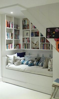 Interior , Creative Interior Design Under Stairs Ideas : Small But Comfy Reading Nook Under The Stairs by angelica
