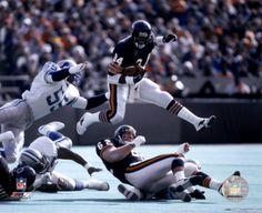 Walter Payton broke Jim Brown's all-time career rushing mark for the NFL in 1984, and became a Chicago Bears legend during his career, from 1975 until 1986. Sweetness was known for his dives and leaps over defenders, especially at the goal line.