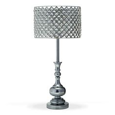 Crystal Clear. It's no surprise that the bejeweled metal and acrylic shade is the star of our Glass Crystal table lamp. Its dazzling geometric arrangement of crystals is nicely complemented by a polished chrome base and, together, swank and simplicity combine to create a show-stopping piece.