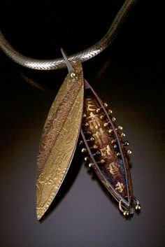 Celie Fago's pierced pod pendant  love pod like art