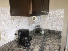 Dark cabinets and DYI mother of pearl kitchen backsplash. Mosaic Tile Designs, Mosaic Wall Tiles, Mosaic Glass, Lowes Tile, Mother Of Pearl Backsplash, Shower Wall Panels, Concrete Tiles, Tile Installation, Decorative Tile