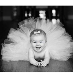 Yes, if we ever are blessed with a girl the second she can hold herself up like this...it's tutu picture time ; )