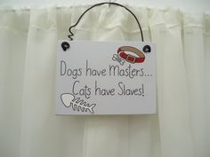 Handmade 'Dogs have masters, cats have slaves!' wooden plaque on Etsy, £7.50