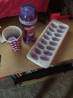 Gain fireworks or downy unstoppables...fill ice tray slots and microwave. Stay by microwave so it doesn't melt. Pop the tray in the freezer for a few minutes and voila- homemade wax melts