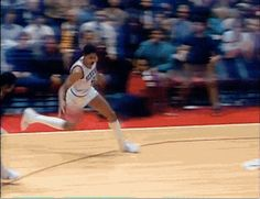 The classic Julius Erving cradle dunk! http://www.prosportstop10.com/top-10-scorers-in-nba-history/