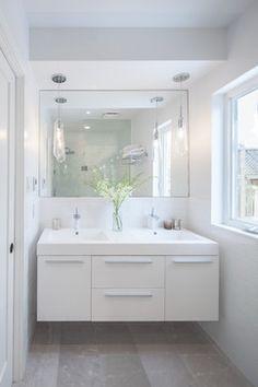 mirror/lighting/all white floating vanity.  Degrassi - contemporary - Bathroom - Toronto - Wanda Ely Architect Inc.