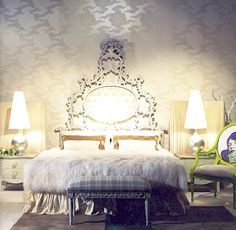Baroque Bedroom design with ornate headboard, dramatic lamps, and a funky green side chair.