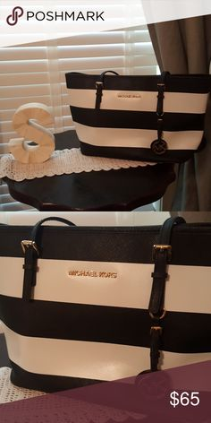 Michael Kors Purse Black and white striped Michael Kors purse. Has adjustable straps. Excellent condition. Like New! No flaws to mention. Michael Kors Bags Totes