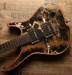 Gorgonized Nemesis with real Black&Gold Marble stone top. Insane artwork - insane sound !! Find out more at www.zerberus-guitars.de