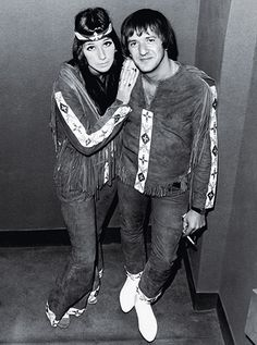 Sony and Cher pose in Native American-inspired outfits created by Nudie.