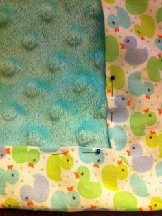 Tuck (measured and cut) soft fabric underneath the border. Pin in place.
