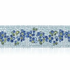 Tiffany designers create magic from the miracles of the natural world. A bracelet of sapphires, tsavorites and diamonds in platinum.