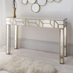 Verbier Console Table  An elegant, striking console table in a beautiful gold finish with geometric mirror shapes.