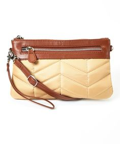 b3814f4bec38 Tote your phone with this sleek purse that offers removable wrist and  shoulder straps