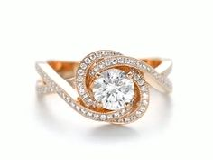 Rose Gold Criss Cross Twisted Halo Diamond Engagement Ring This gorgeous engagement ring features a round brilliant cut diamond prong set in the center of an intertwining halo of . Gold Rings Jewelry, Fine Jewelry, Gold Bracelets, Jewelry Box, Antique Jewelry, Metal Jewellery, Turquoise Jewellery, Jewelry Making, Stackable Bracelets