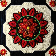 """View the detailed quilting by Laurie Vandergriff on a block of the """"Sunflower Fiesta"""" quilt from Happy Stash Quilts by Marcia Harmening."""