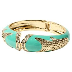 Pairing a gold-hued finish with turquoise enamel and Austrian crystal accents, this chic cuff bracelet adds a bright finishing touch to your daytime outfits ...