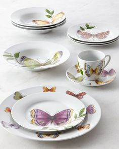 #ONLYATNM Only Here. Only Ours. Exclusively for You. Made of porcelain. Salad plates and soup bowls feature four different designs; dinner plates are all alike. Dishwasher and microwave safe. Service